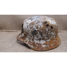 Battle damaged winter camo relic Helmet M35